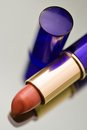 Reddish lipstick on reflective surface Royalty Free Stock Images