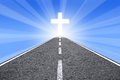 Redemption a road go ahead to a cross which can be used for religious concepts Stock Photos