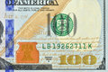 Redesigned hundred american dollars macro image new look banknote front right down corner Royalty Free Stock Image