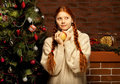 Redhair christmas woman wit apple. Stock Photography