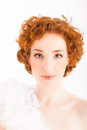 Redhaired woman portrait of a with white feather boa Royalty Free Stock Image