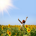 Redhaired woman in sunflower field Royalty Free Stock Photo