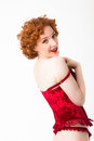 Redhaired woman wearing red lingerie Stock Photography