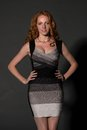 Redhead beautiful tall in a striped dress Stock Photography