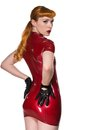 Redhead beautiful young in a red latex dress Royalty Free Stock Photos