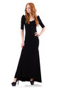 Redhead in black dress isolated on white Royalty Free Stock Image