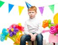 Redhead boy among balloons funny little birthday Royalty Free Stock Photos