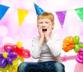 Redhead boy among balloons funny little birthday Stock Images