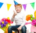 Redhead boy among balloons funny little birthday Stock Photos