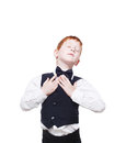 Redhead boy in vest with bow tie, happy and delighted Royalty Free Stock Photo