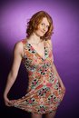 Redhead in a dress Stock Photos