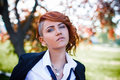 Redhead emotional student portrait at outdoor sexy posing park Royalty Free Stock Images