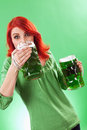 Redhead enjoying green beer Stock Photo