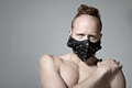 Redhead fashion man model in muzzle concept of freedom of speech censorship restriction and silent copy space Royalty Free Stock Photo