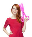 Redhead girl with big scissors Royalty Free Stock Photo
