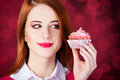Redhead girl with cake. Royalty Free Stock Photo