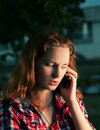 Redhead girl calling by mobile phone Royalty Free Stock Photo