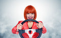 Redhead girl with car wheel and smoke Royalty Free Stock Photo