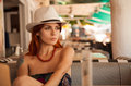 Redhead girl in casual outfit portrait of a bar Royalty Free Stock Image