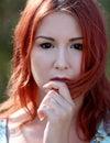 Redhead girl enjoying summer sunlight and calm wind Royalty Free Stock Photo