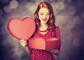 Redhead girl with gift for valentines day photo bokeh at background Royalty Free Stock Images