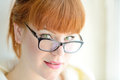 Redhead girl with glasses portrait of caucasian Stock Image