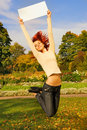 image photo : Redhead girl jumping