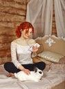 Redhead girl listening to music on headphones Royalty Free Stock Photo