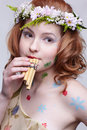 Redhead girl with panflute Royalty Free Stock Photo