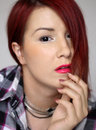 Redhead girl in plaid shirt portrait of the holding her hand at the face Royalty Free Stock Photos