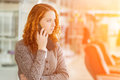 Redhead girl speaking by phone selective focus with shallow depth of field Stock Photo