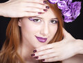Redhead girl with style make-up and flowers Royalty Free Stock Photo