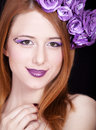 Redhead girl with style make-up and flowers Royalty Free Stock Photography