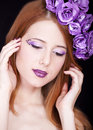 Redhead girl with style make-up and flowers Royalty Free Stock Images