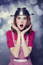 Redhead housewife with colander over head Royalty Free Stock Photos