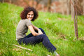 Redhead lady sitting in grass Stock Images