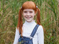 redhead little girl with freckles smiles brightly Royalty Free Stock Photo