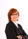 Redhead mature business woman with eyeglasses close up Stock Images