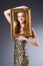Redhead with picture frame against dark background Stock Images