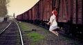 Redhead witch flying on the broom train station Stock Photos