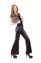 Redhead woman in black bell bottom pants on white Stock Image