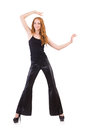 Redhead woman in black bell bottom pants on white Stock Photos
