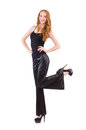 Redhead woman in black bell bottom pants on white Stock Photography