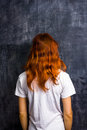 Redhead woman by blank blackboard standing Stock Photo