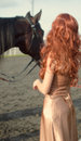 Redhead woman with horse