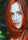Redhead woman portrait of young with long hair Stock Photos
