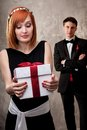 Redhead woman with a present Royalty Free Stock Photo