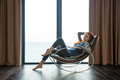 Redhead woman sitting on rocking chair Royalty Free Stock Photo
