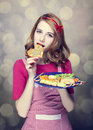 Redhead women with cookies Royalty Free Stock Photography