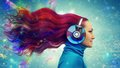 Redhead women listening woman to the music Royalty Free Stock Image